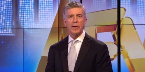 Tom Bergeron stands in front of the AFV screens