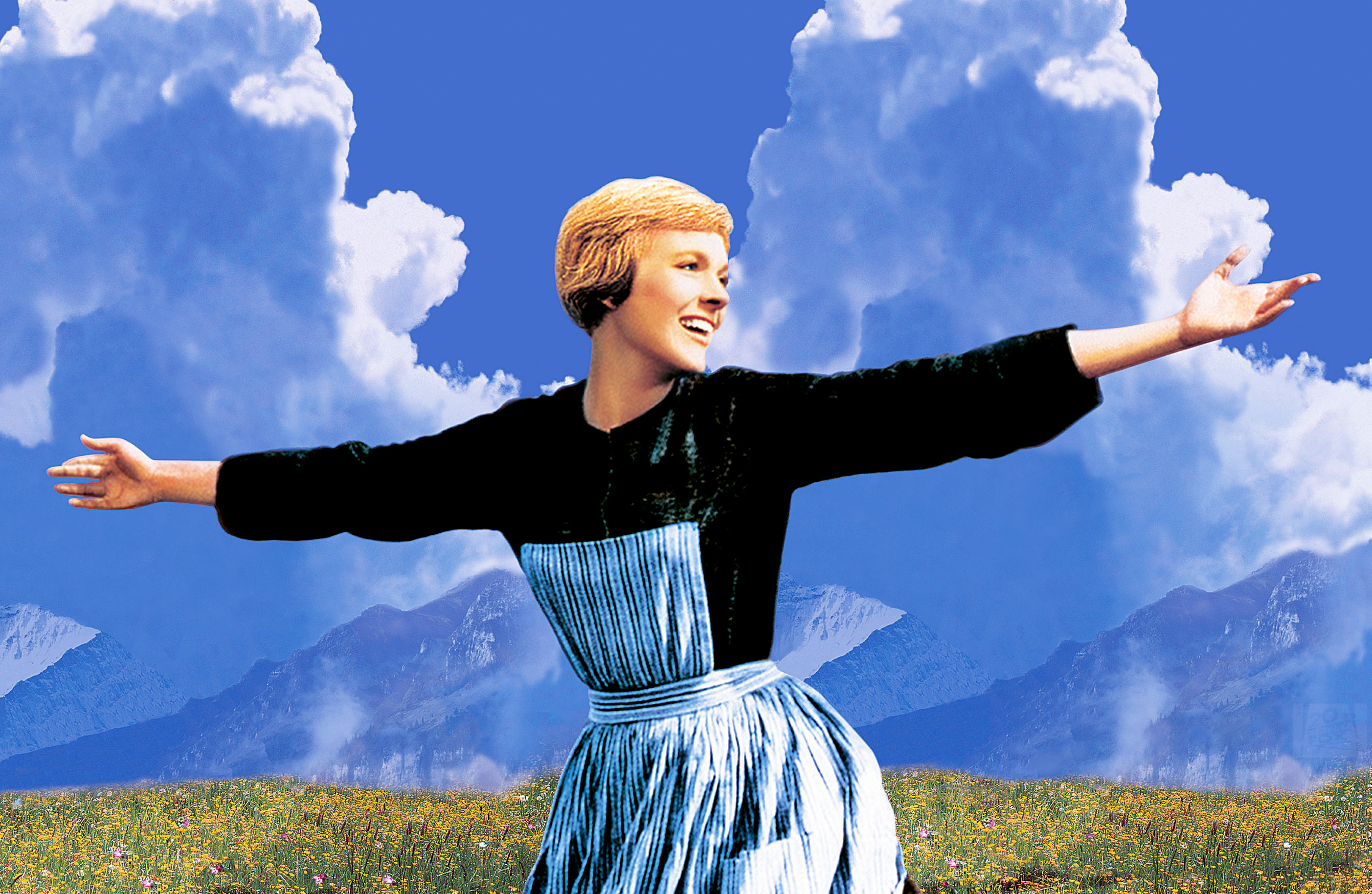 Julie Andrews sings on a mountaintop