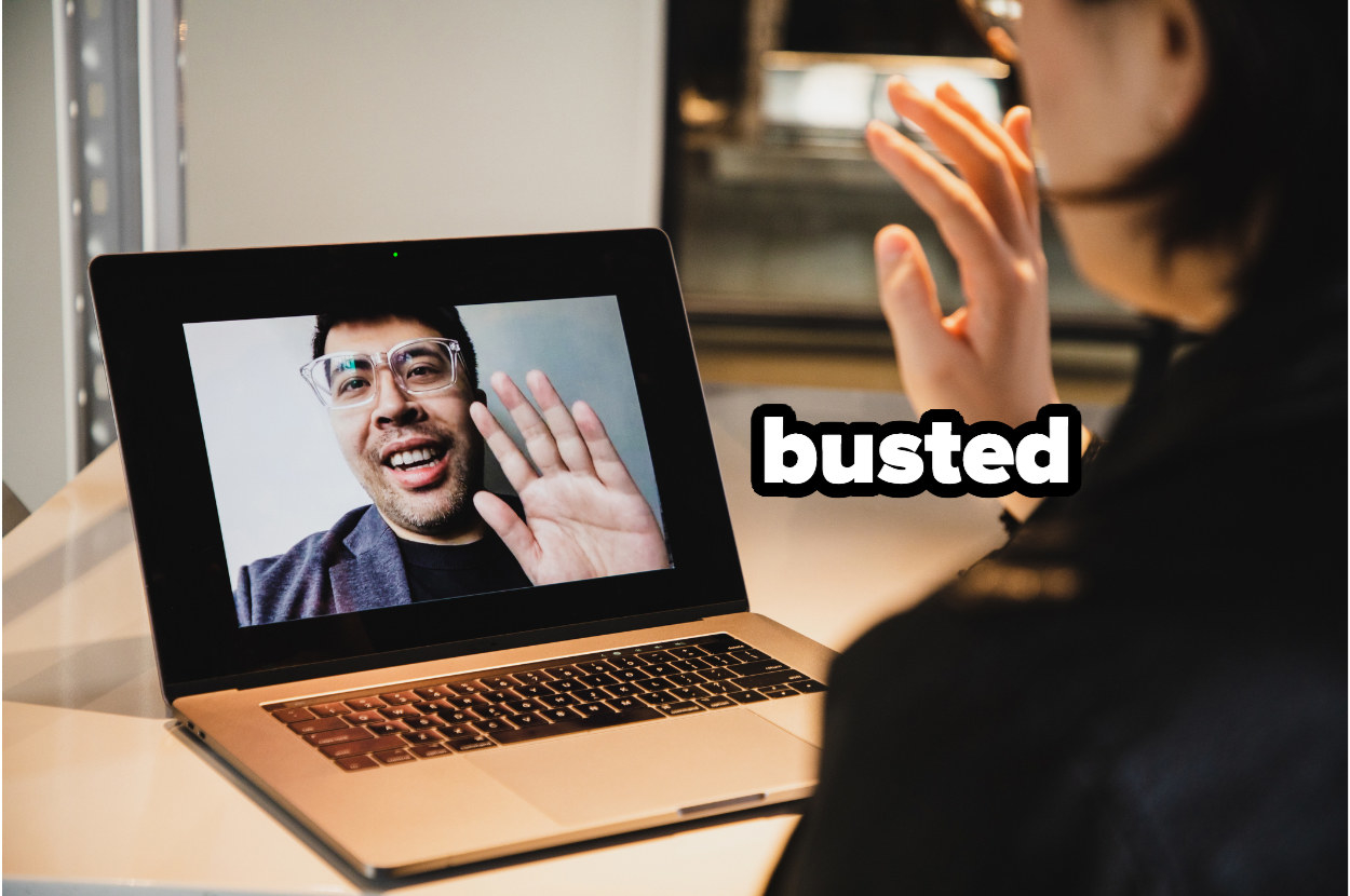 """person conducting a video interview with the word """"busted"""" by the computer"""