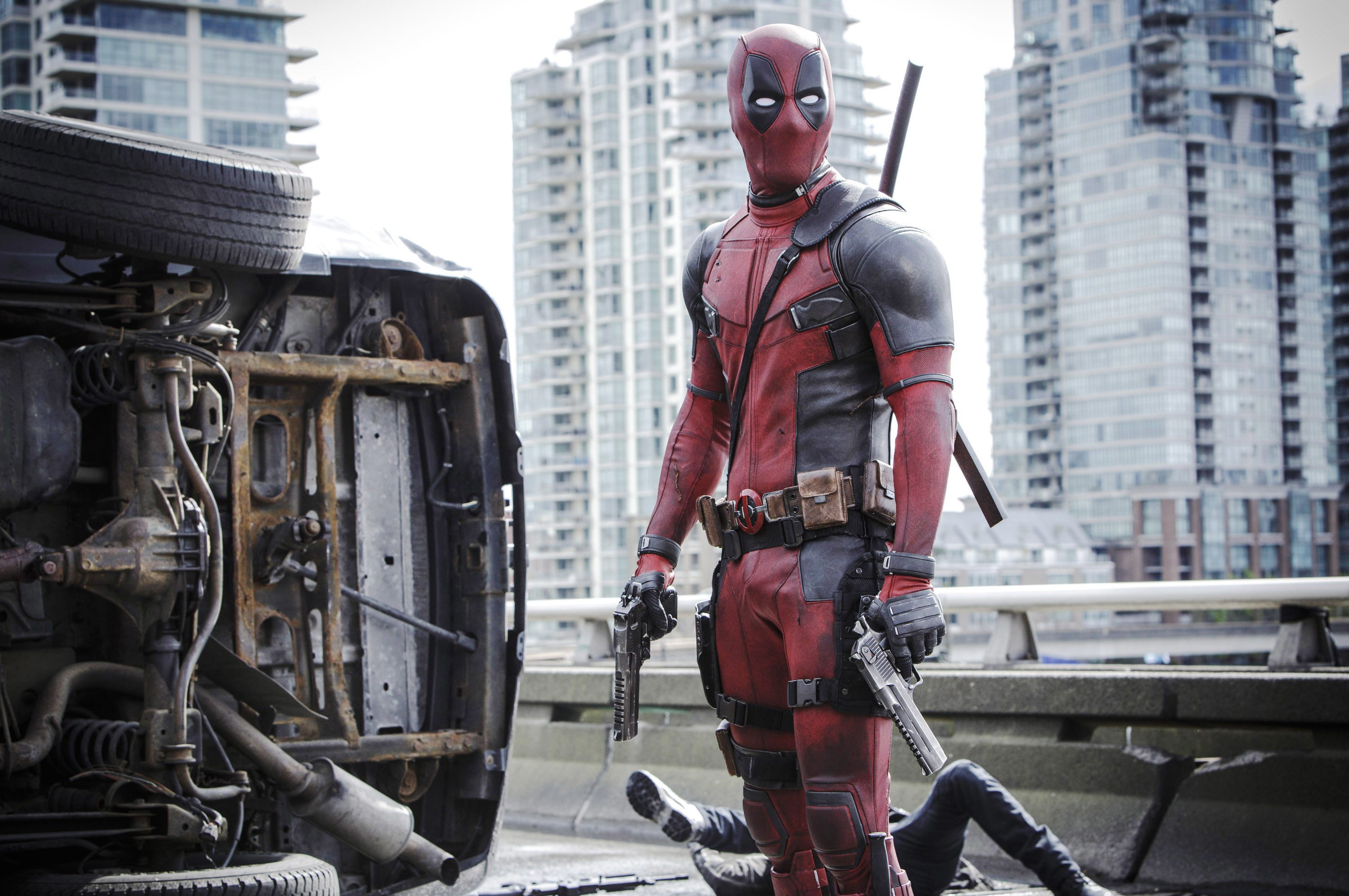 Ryan Reynolds as Deadpool in a skin-tight red and black suit