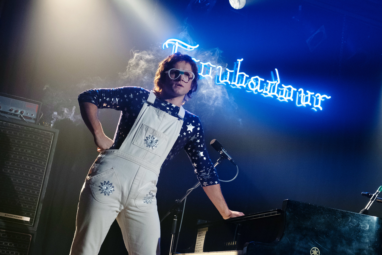Taron Egerton as Elton John in front of the Troubadour sign