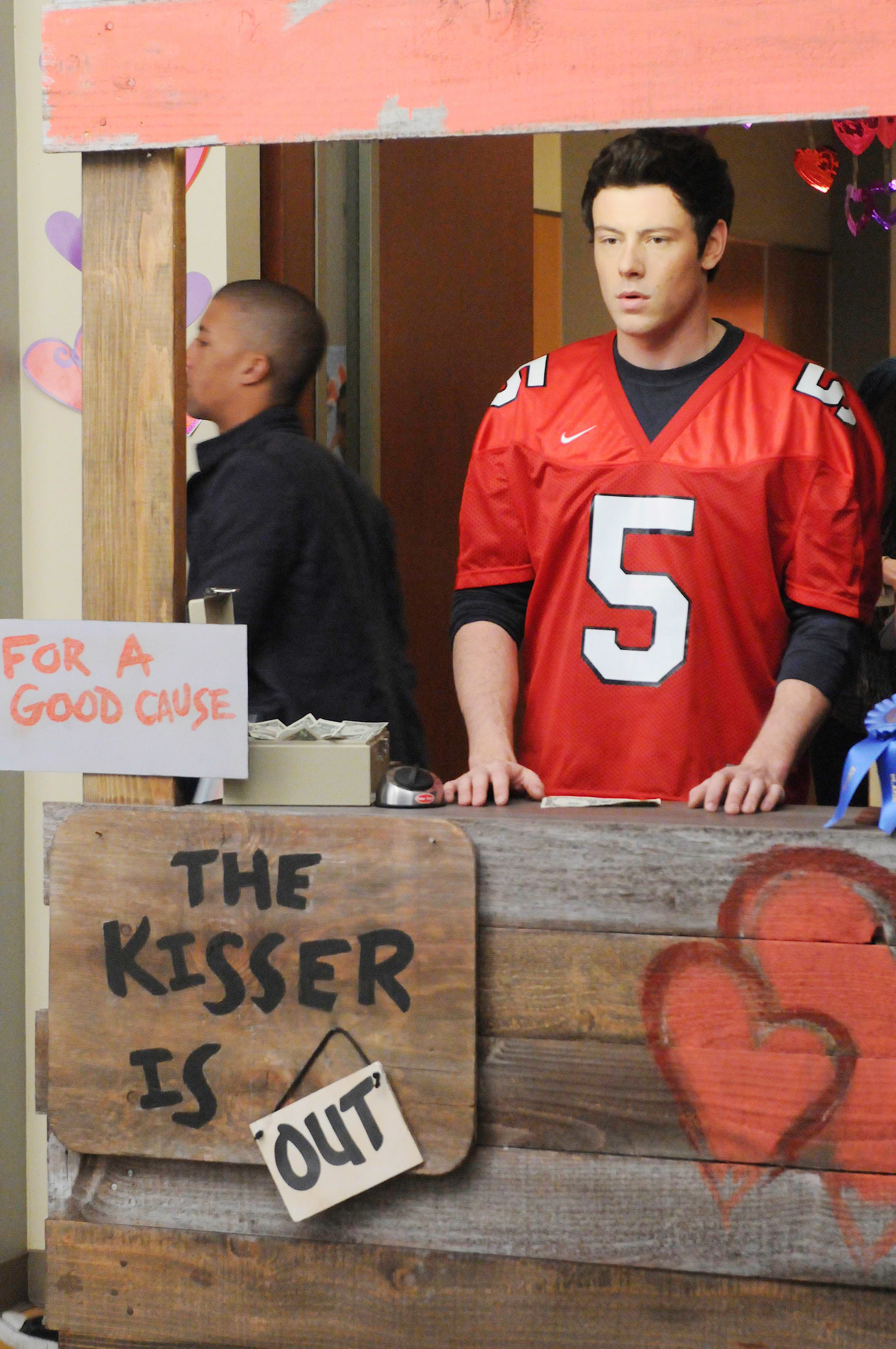 """Cory Monteith wearing a football jersey on the set of """"Glee"""""""