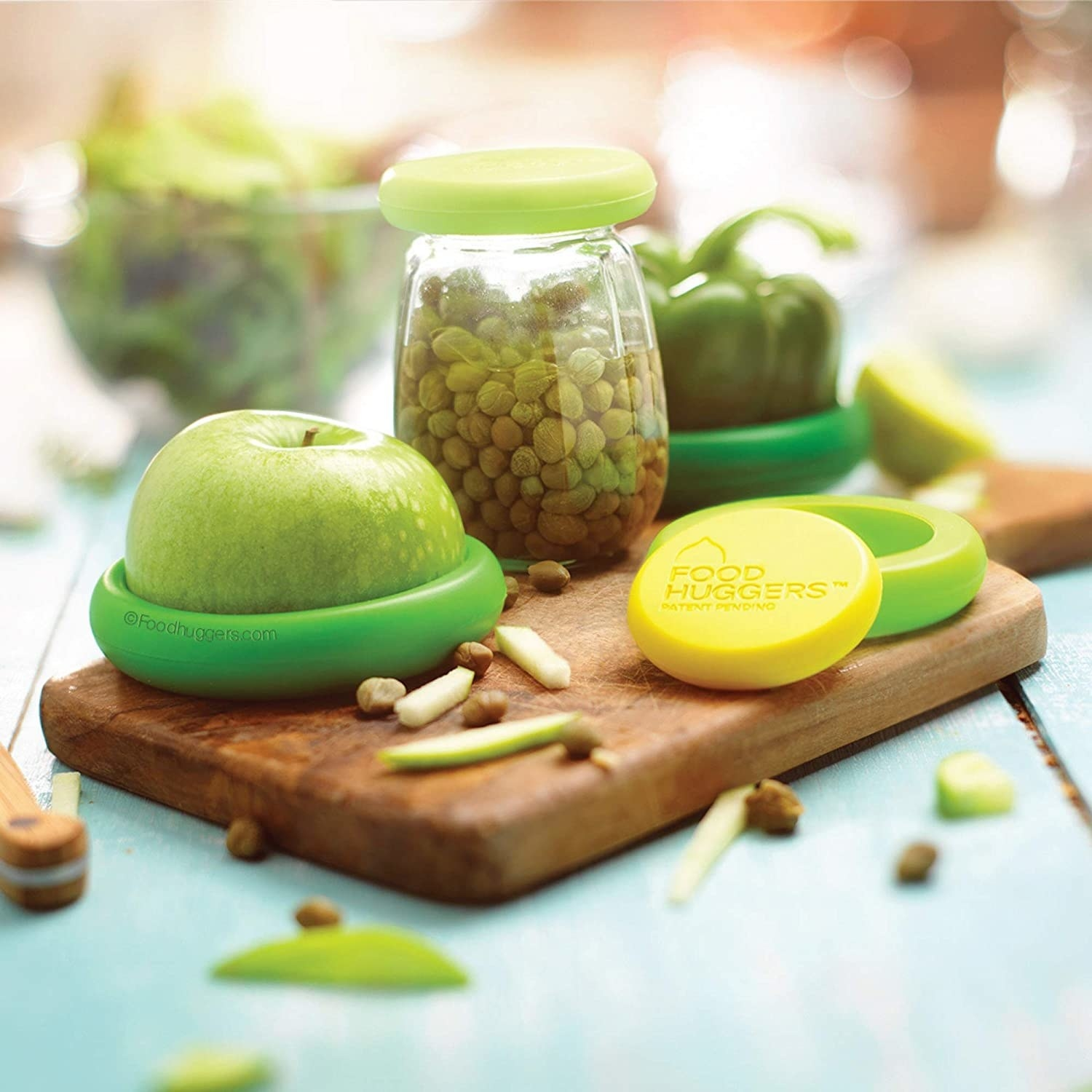 A set of food covers stretched to fit over fresh fruit and a jar of capers