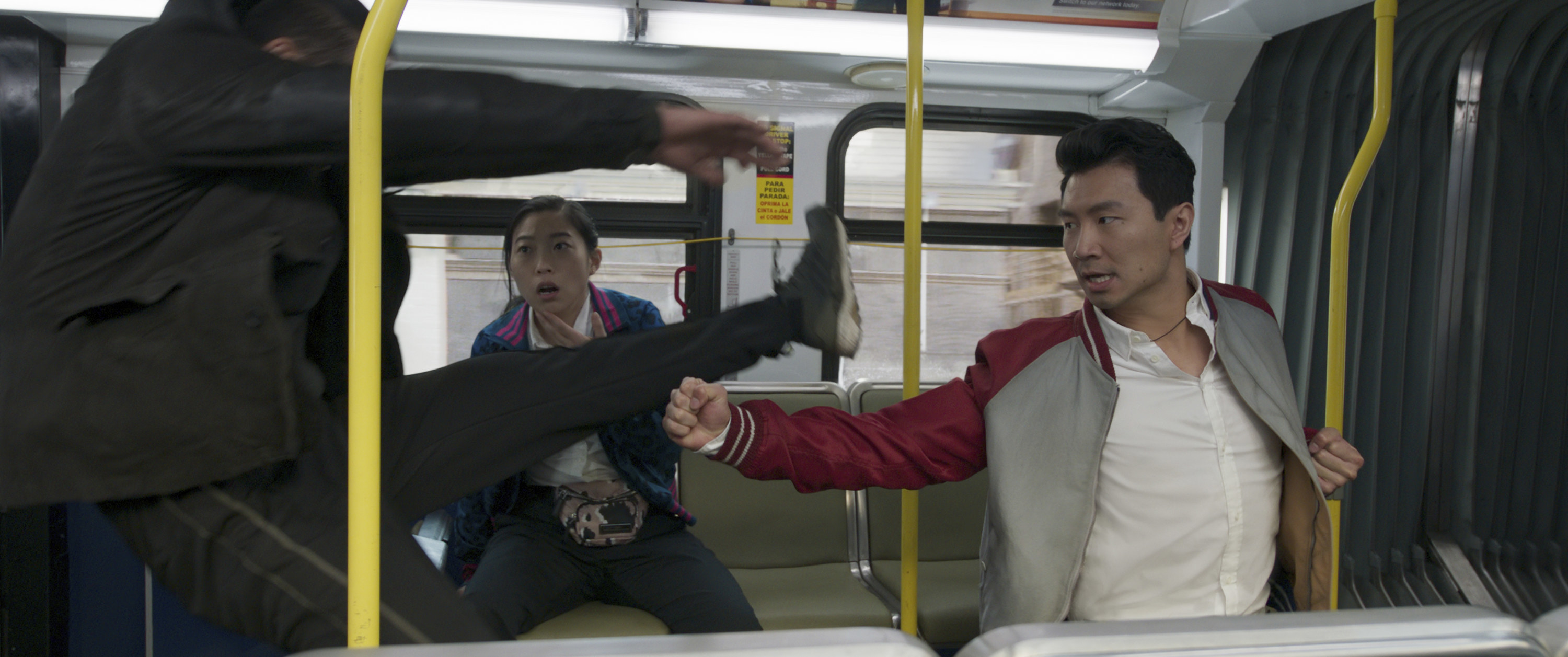 Shang-chi fighting on a moving bus