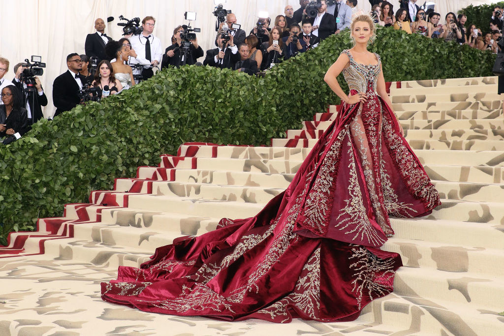Blake Lively posing on the steps of the Met Gala
