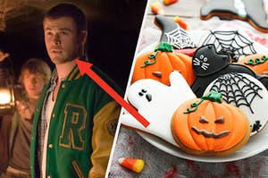Curt Vaughan stands in a darkened room wearing a letterman jacket and a tray of Halloween shaped cookies