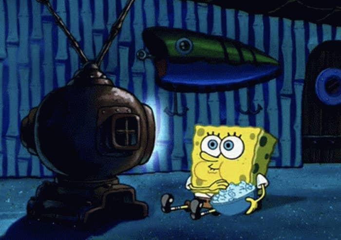SpongeBob SquarePants eating popcorn and watching TV