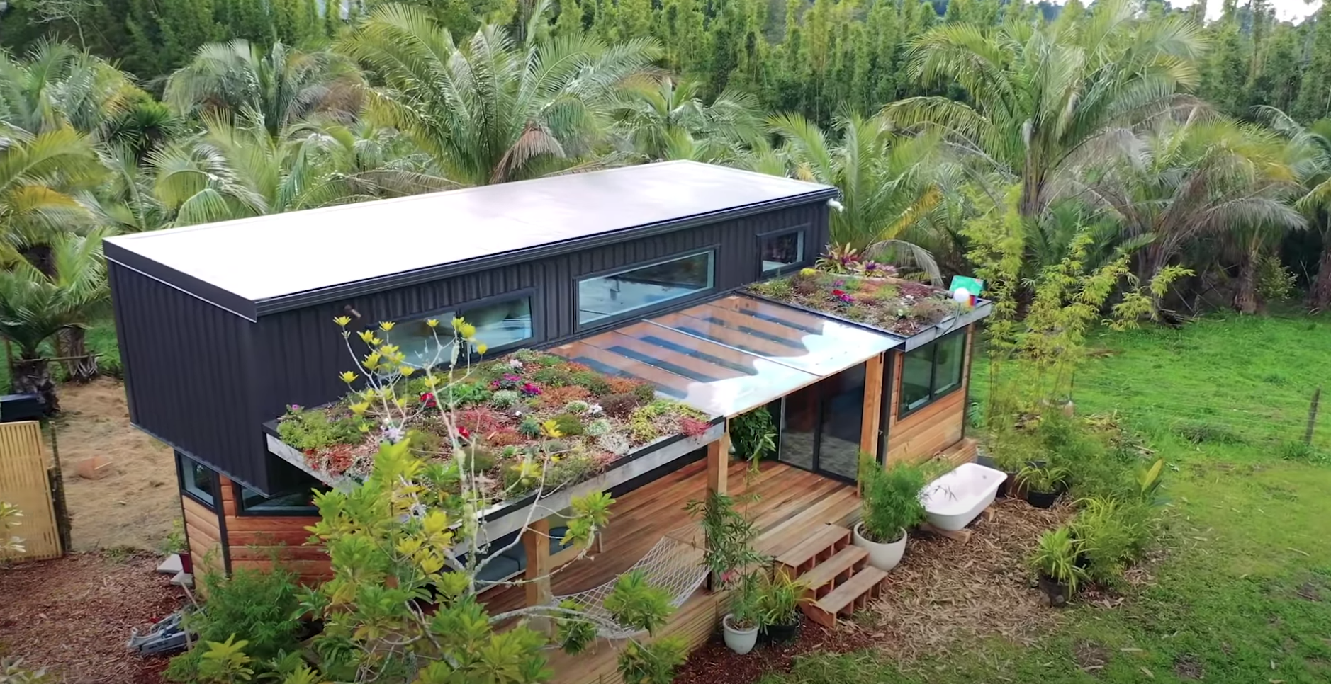 A beautiful home in a tropical paradise with a lush garden on the roof
