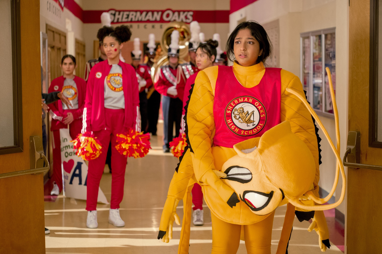 Devi wearing a mascot costume in the high school hallway