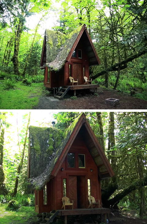 A wood cabin with a whimsical tall roof and a charming front porch