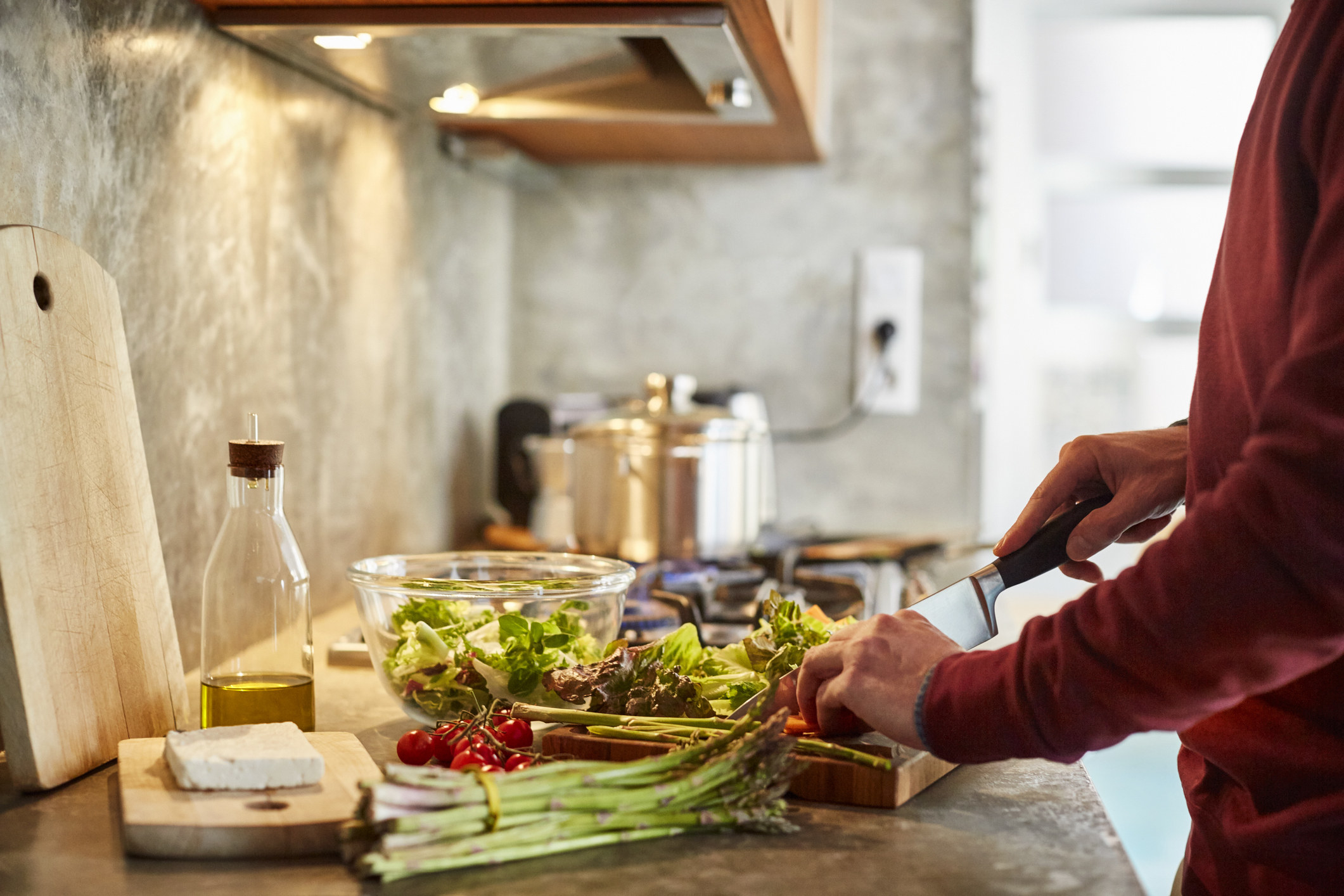 A woman cooking vegetables.