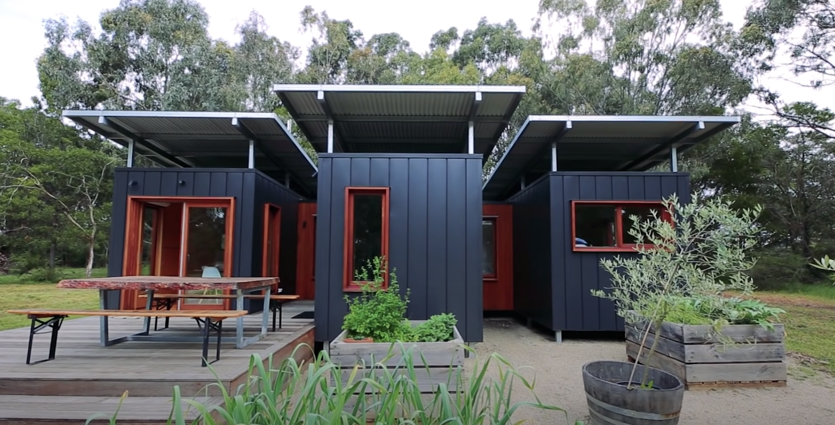 A very modern and sleek home made from three connected shipping containers