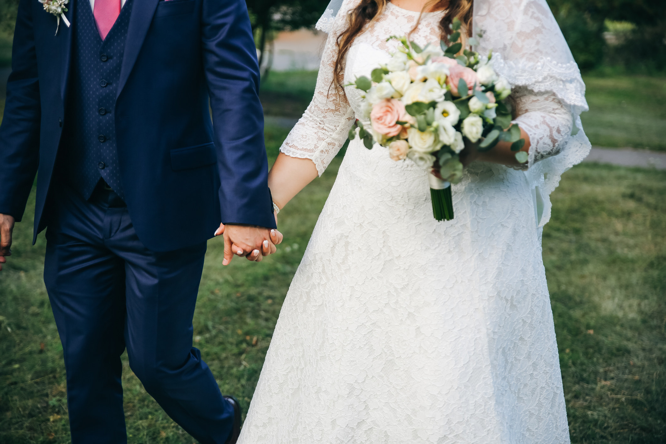 a bride walking with her bouquet