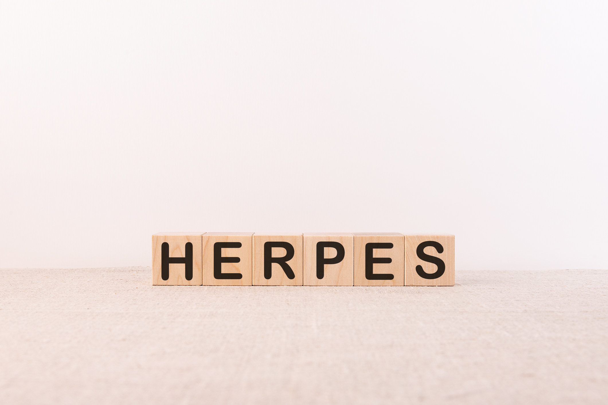 """Block letters spelling out """"Herpes"""""""