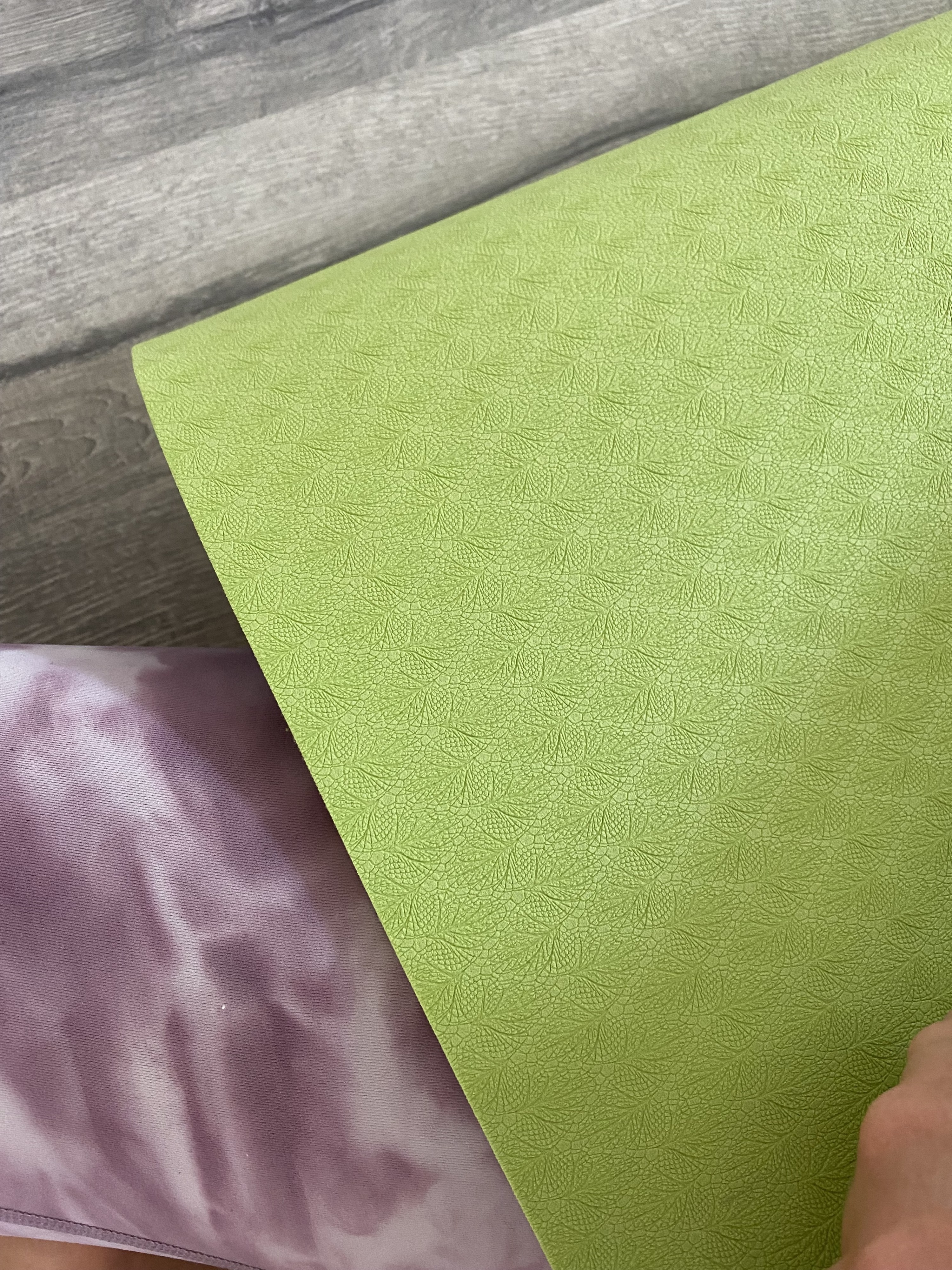 The bottom of the yoga mat, which is textured for grippiness
