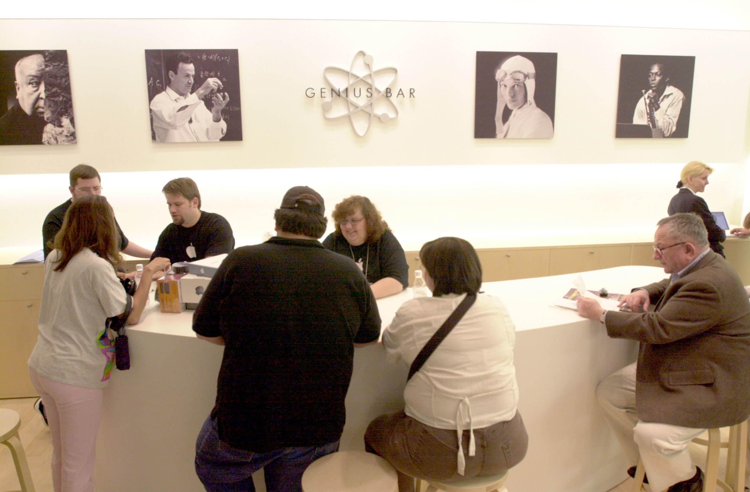 Photo of people sitting at a Genius Bar