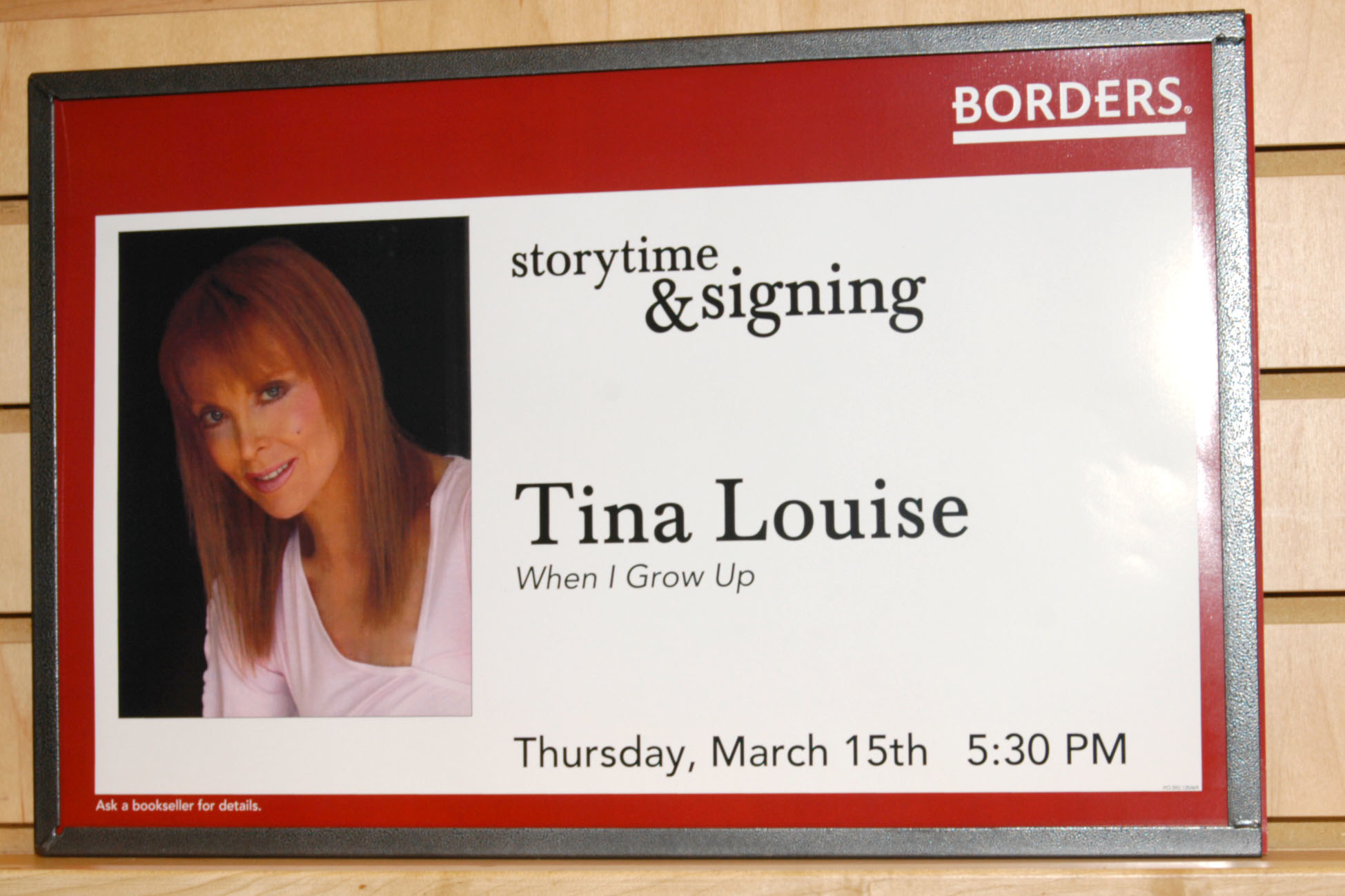 Borders sign that says storytime and singing with Tina Louise