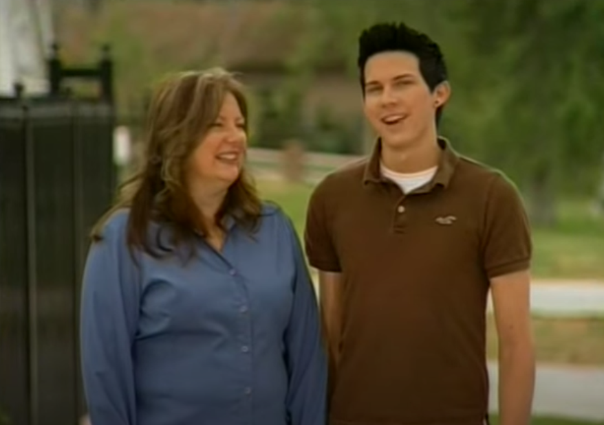 A mom standing next to her son