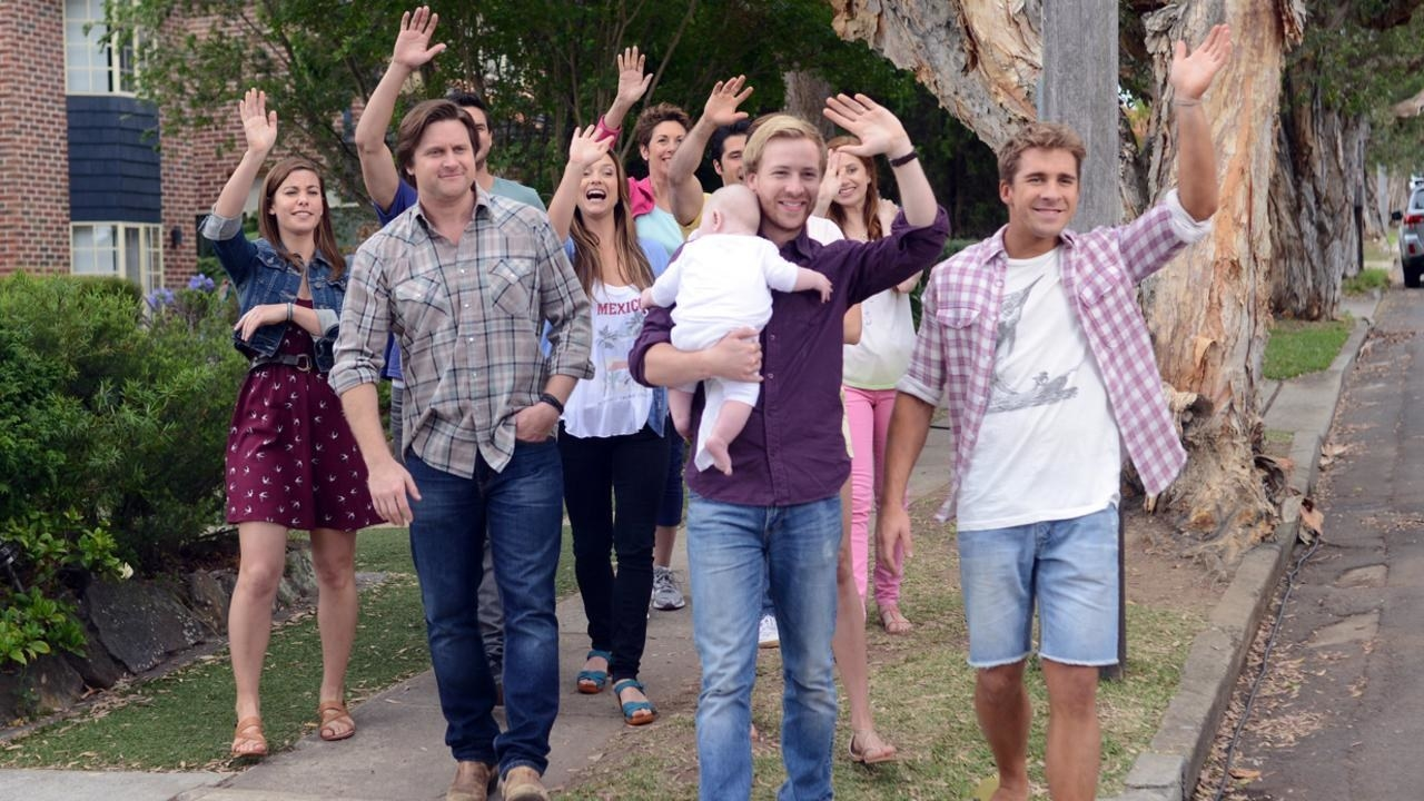 The Rafter family waving goodbye