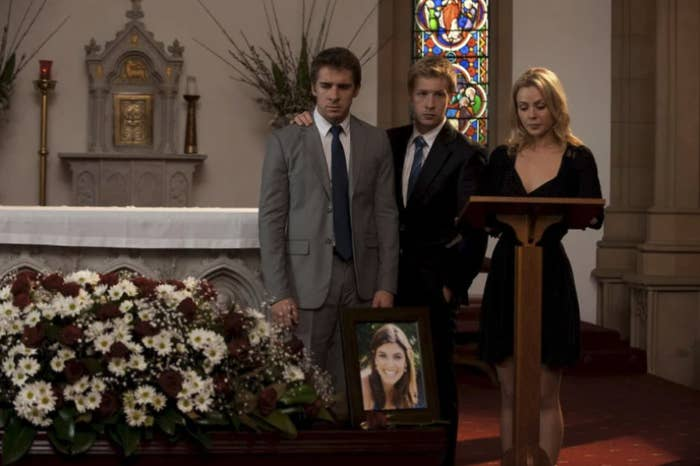 The Rafter family at a funeral mourning Melissa's death