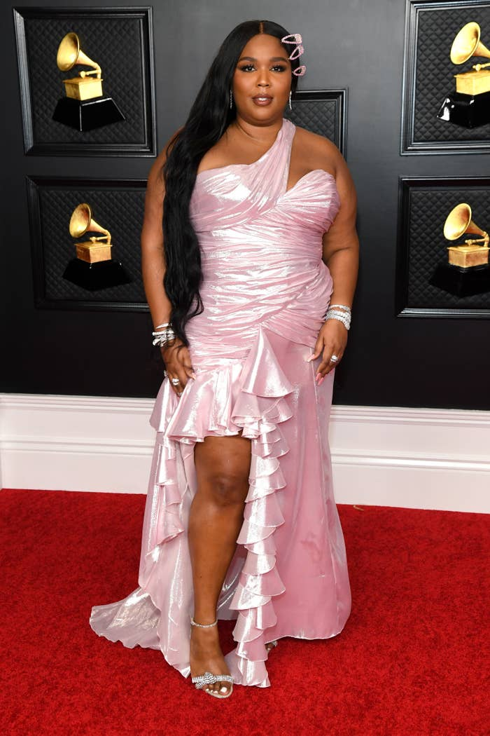 Lizzo on the Grammys red carpet in a one-shouldered ruffled gown