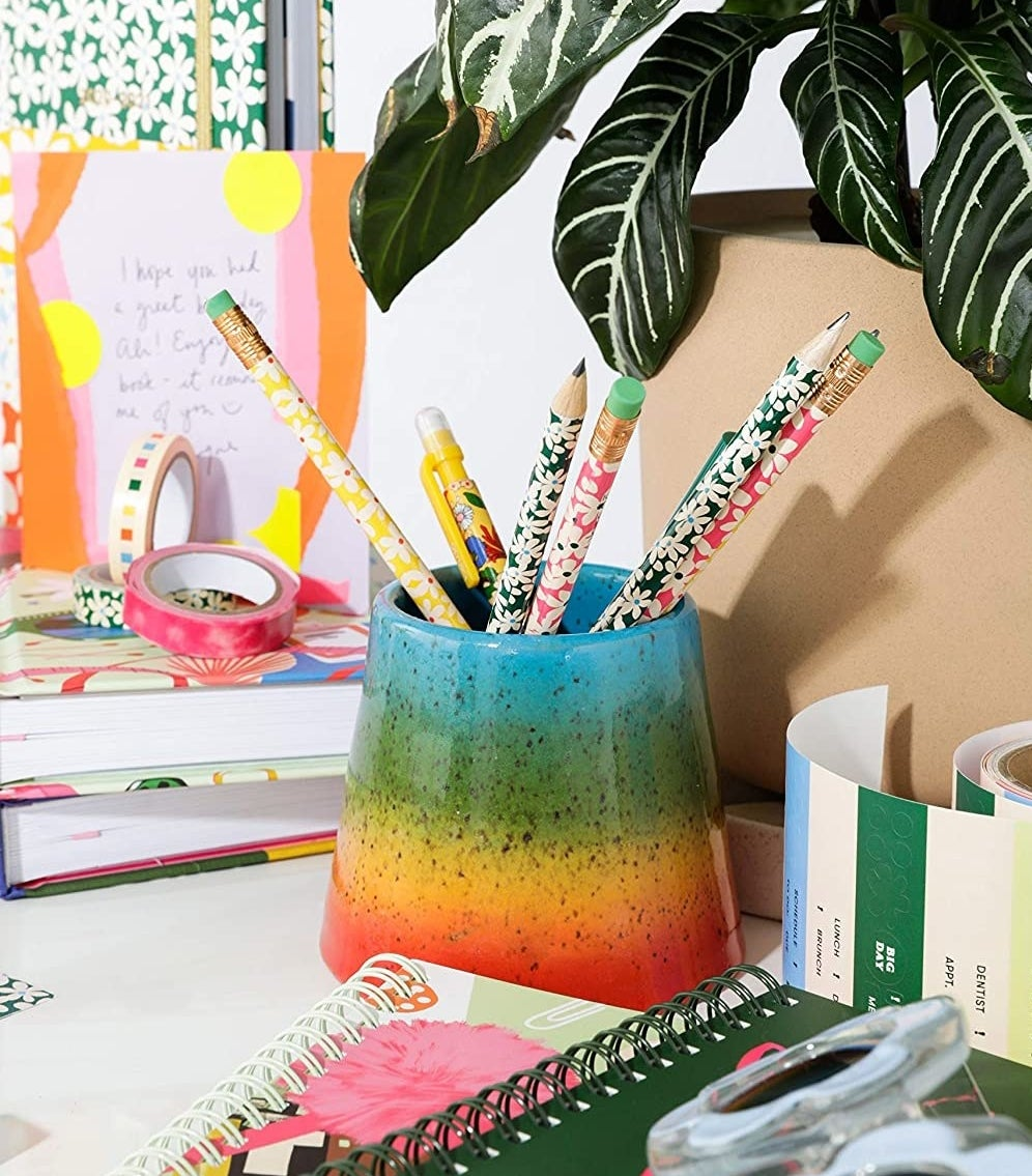 A bunch of pencils in a small jar