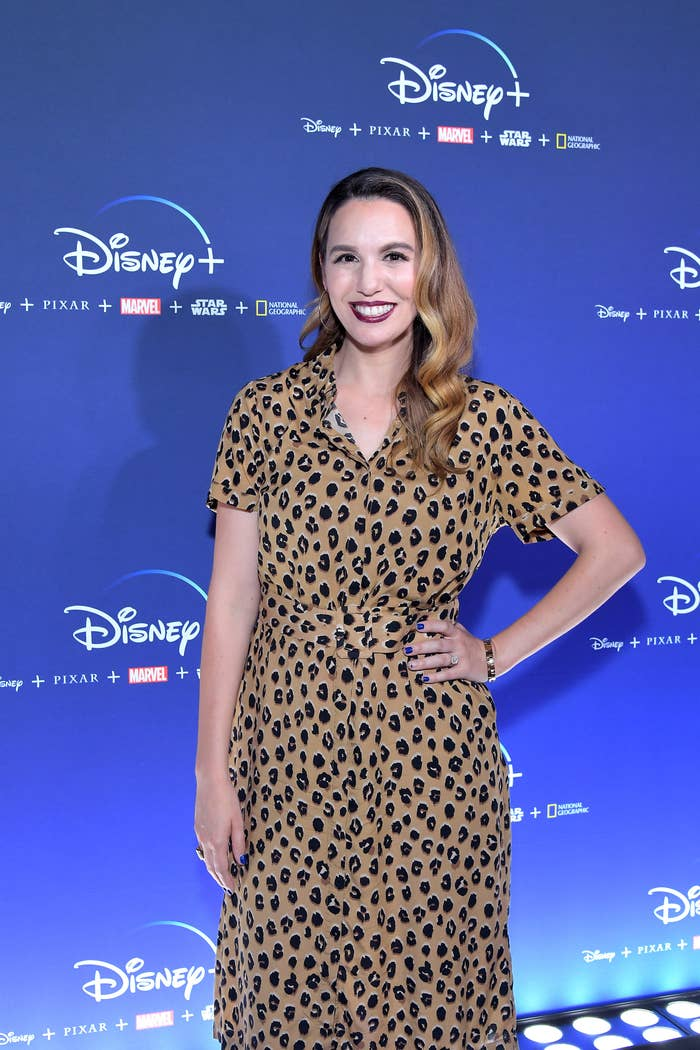 Christy in a leopard print dress at a red carpet event