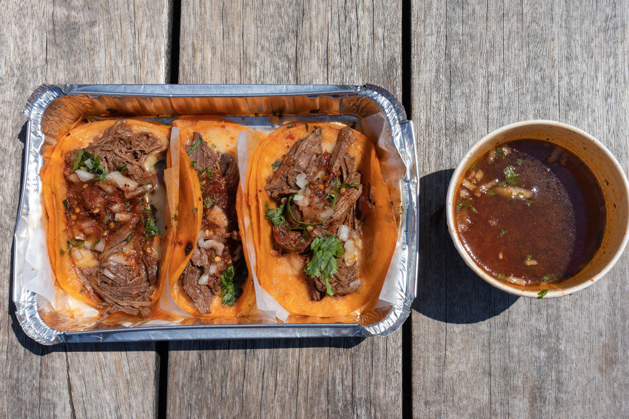 Mexican birria tacos and consomme.