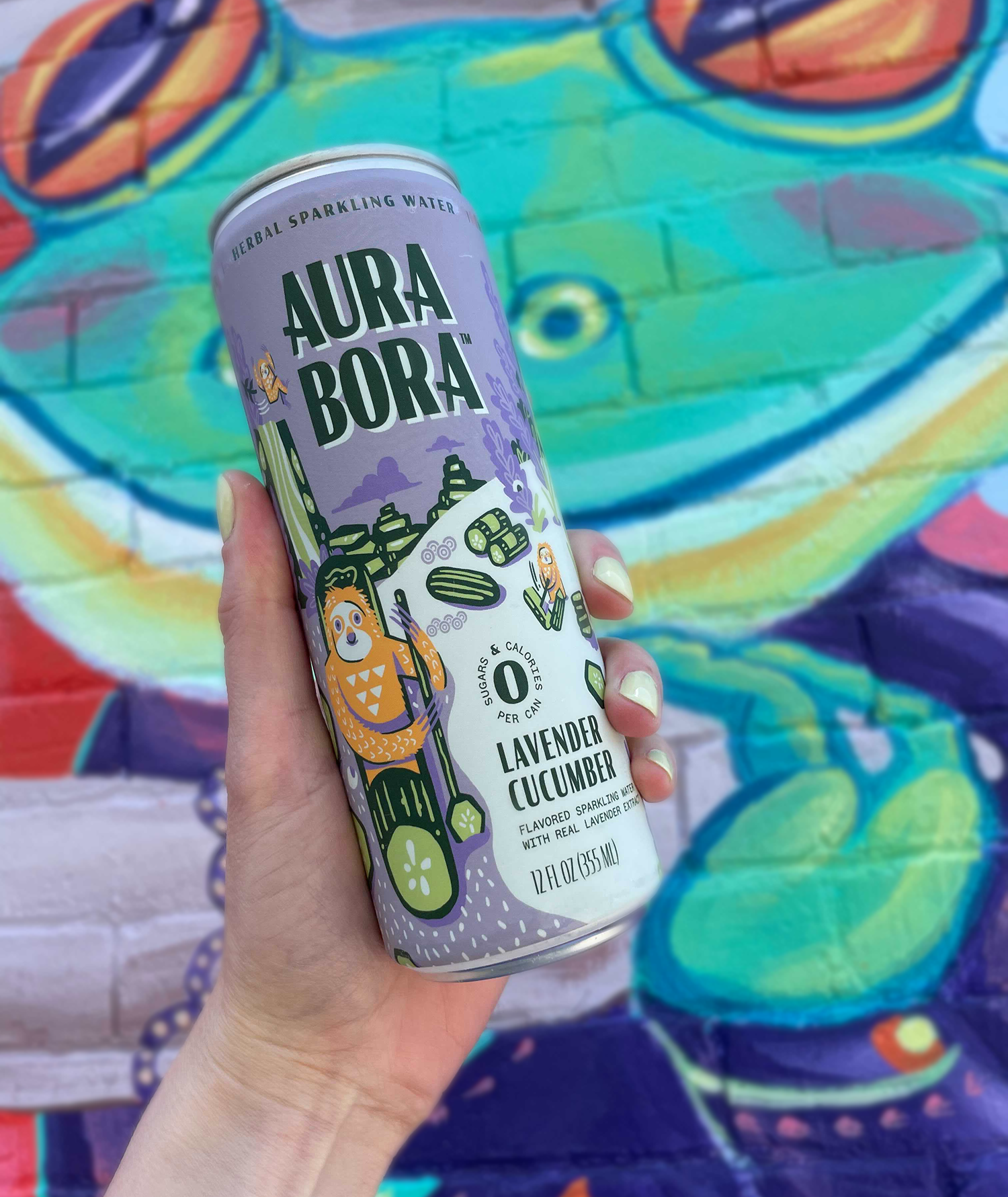 can of lavender cucumber seltzer with illustration of sloth and cucumbers