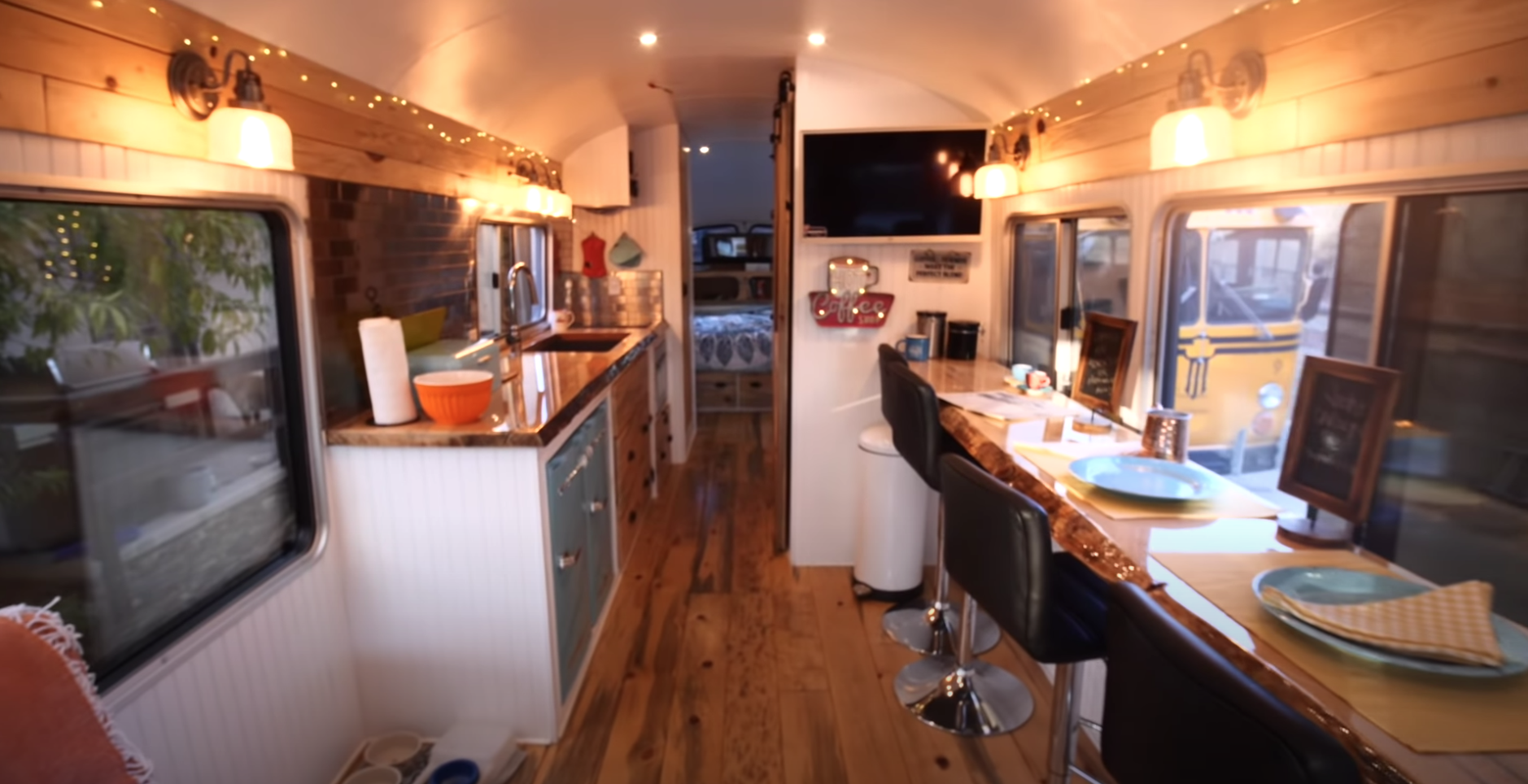 Inside the bus, there is plenty of seating to eat and a kitchen