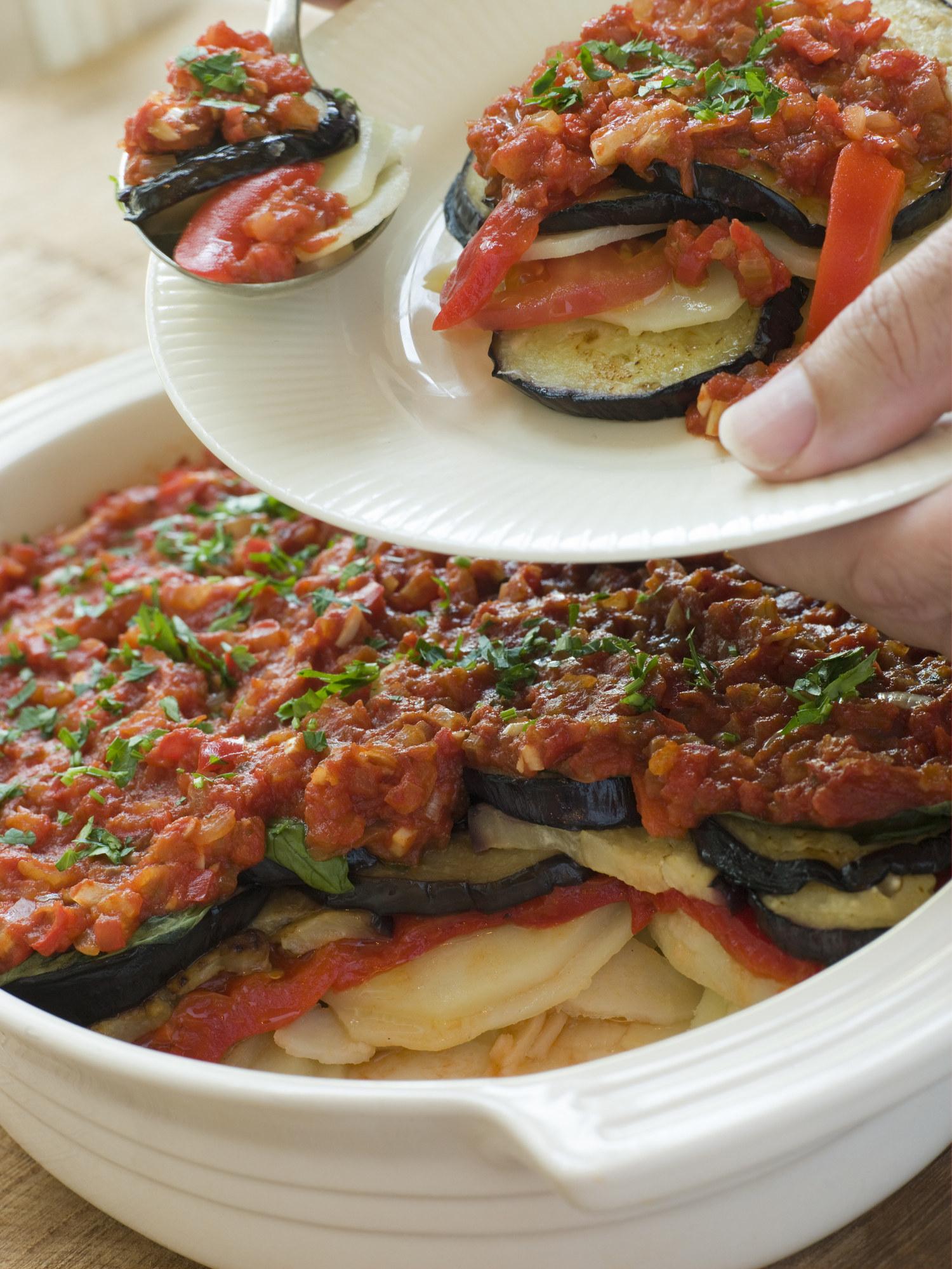 Tumbet aka eggplant layered with potato and tomato sauce.