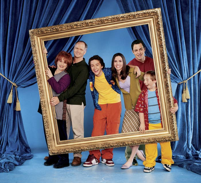 A promotional photo featuring the family from Even Stevens holding up an oversized picture frame