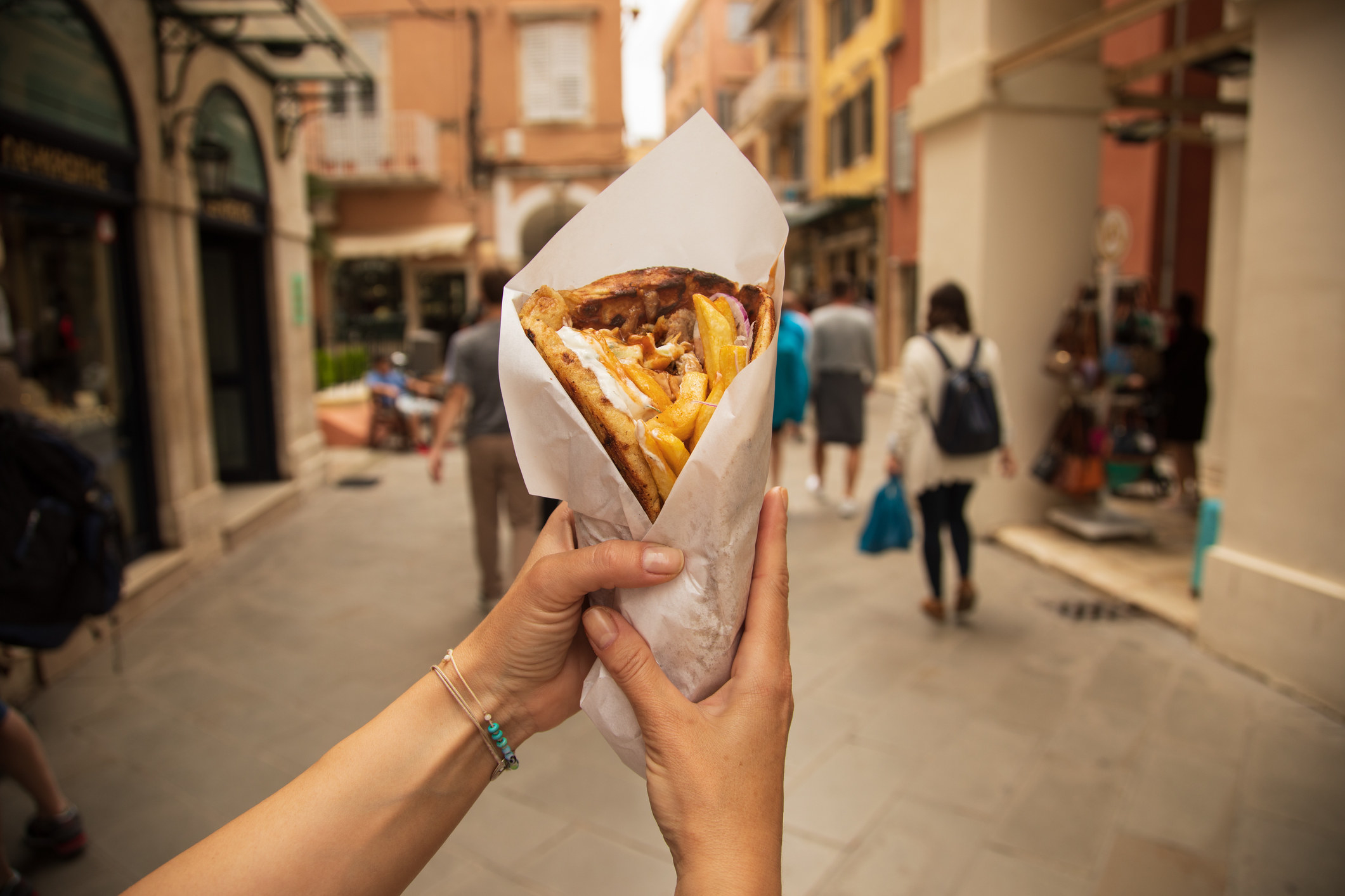 A gyro with fries.