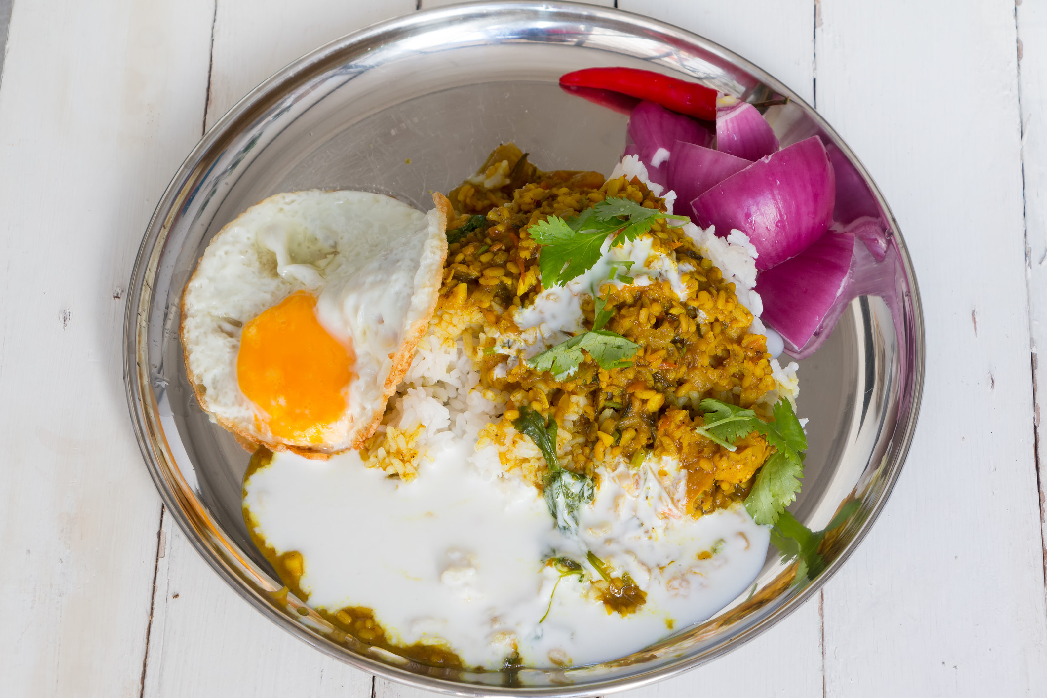 Nepalese curry over rice with an egg.