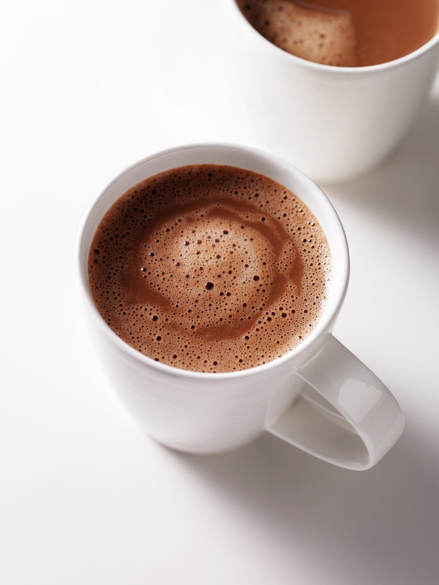 Two mugs of hot chocolate.