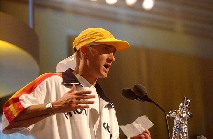 Eminem talking into the mic onstage at the 2002 MTV VMAs