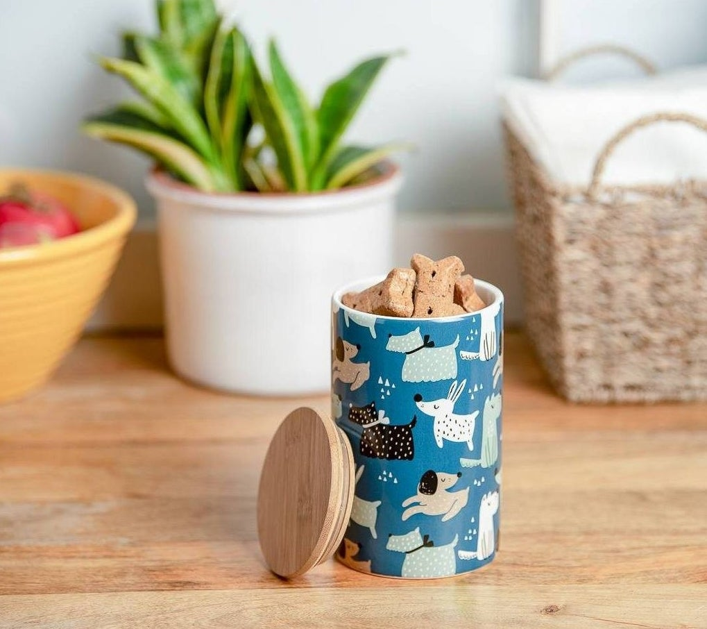 the blue dog-print canister which has a bamboo lid