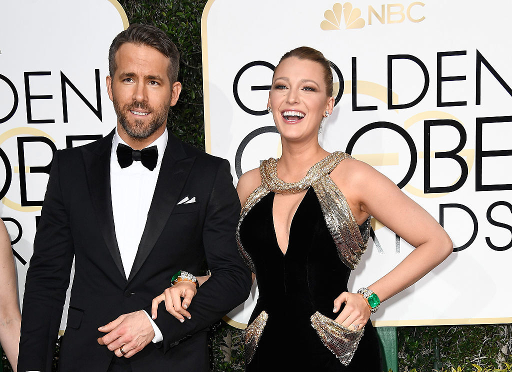 Ryan Reynolds (L) and Blake Lively on the 74th Annual Golden Globe Awards red carpet