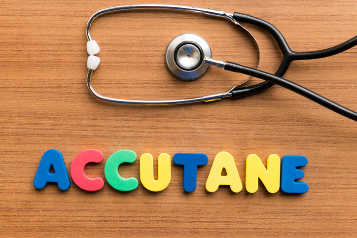 The word accutane spelled out on a desk with a stethoscope above it