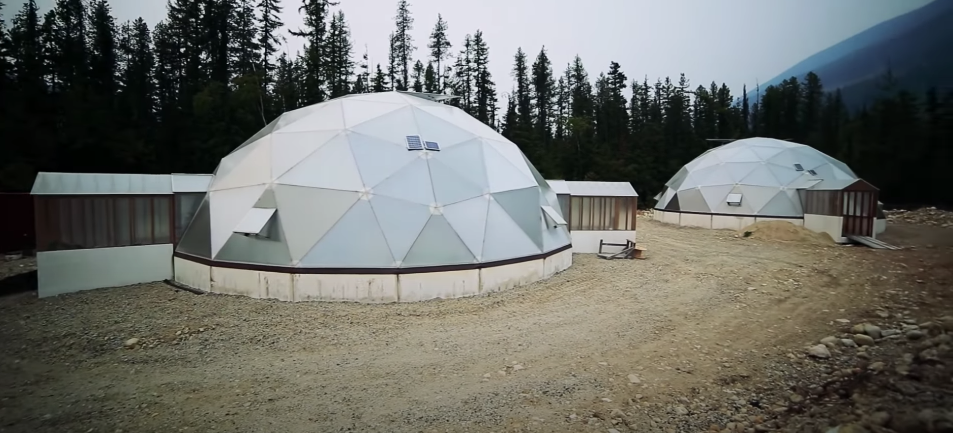 Two futuristic-looking dome greenhouses outside