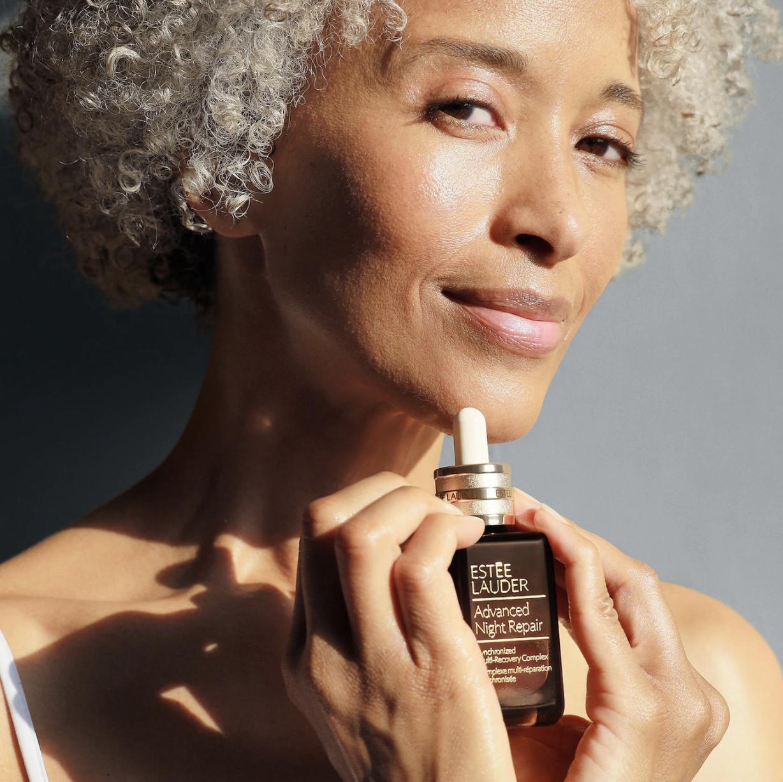 model holding the bottle of serum