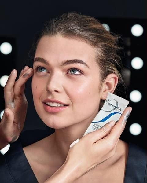 Model applyingEmbryolisse Lait-Crème Concentré to other model's face
