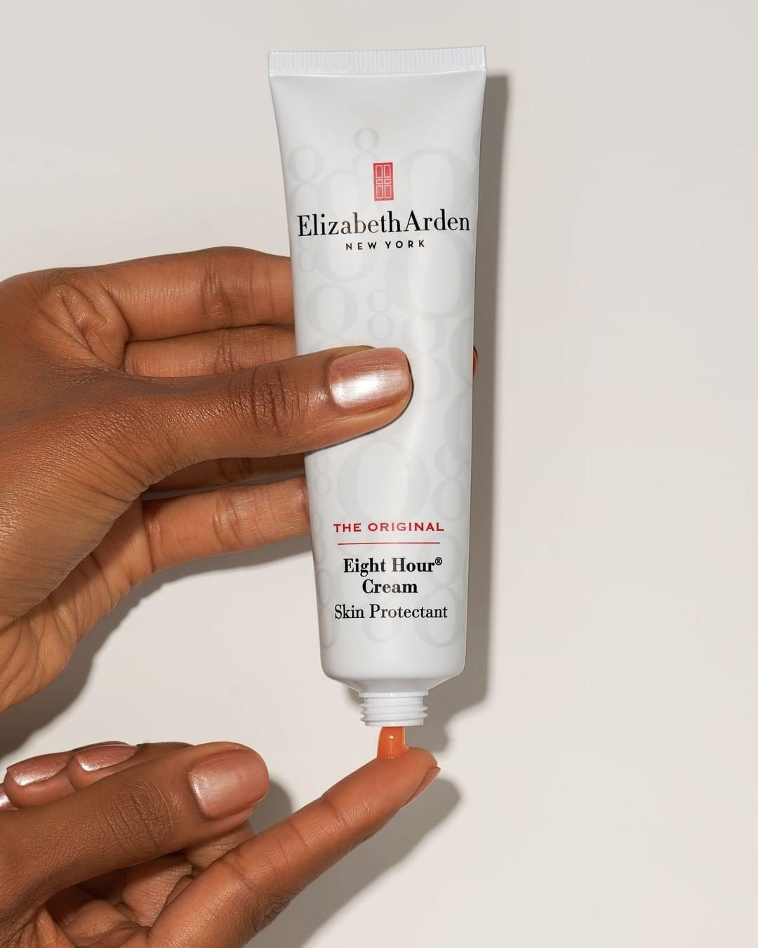 Model applying Elizabeth Arden Eight Hour Cream to fingertip