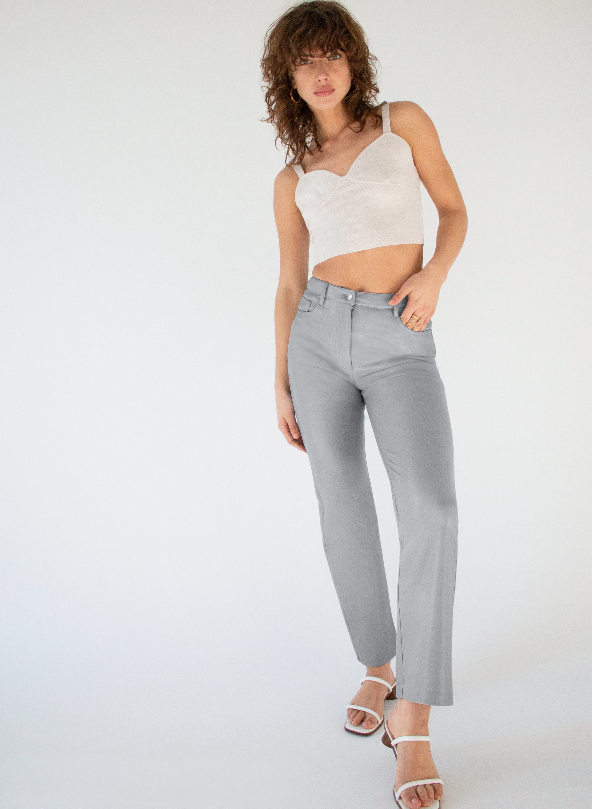 model wearing the cropped faux leather pants in blue