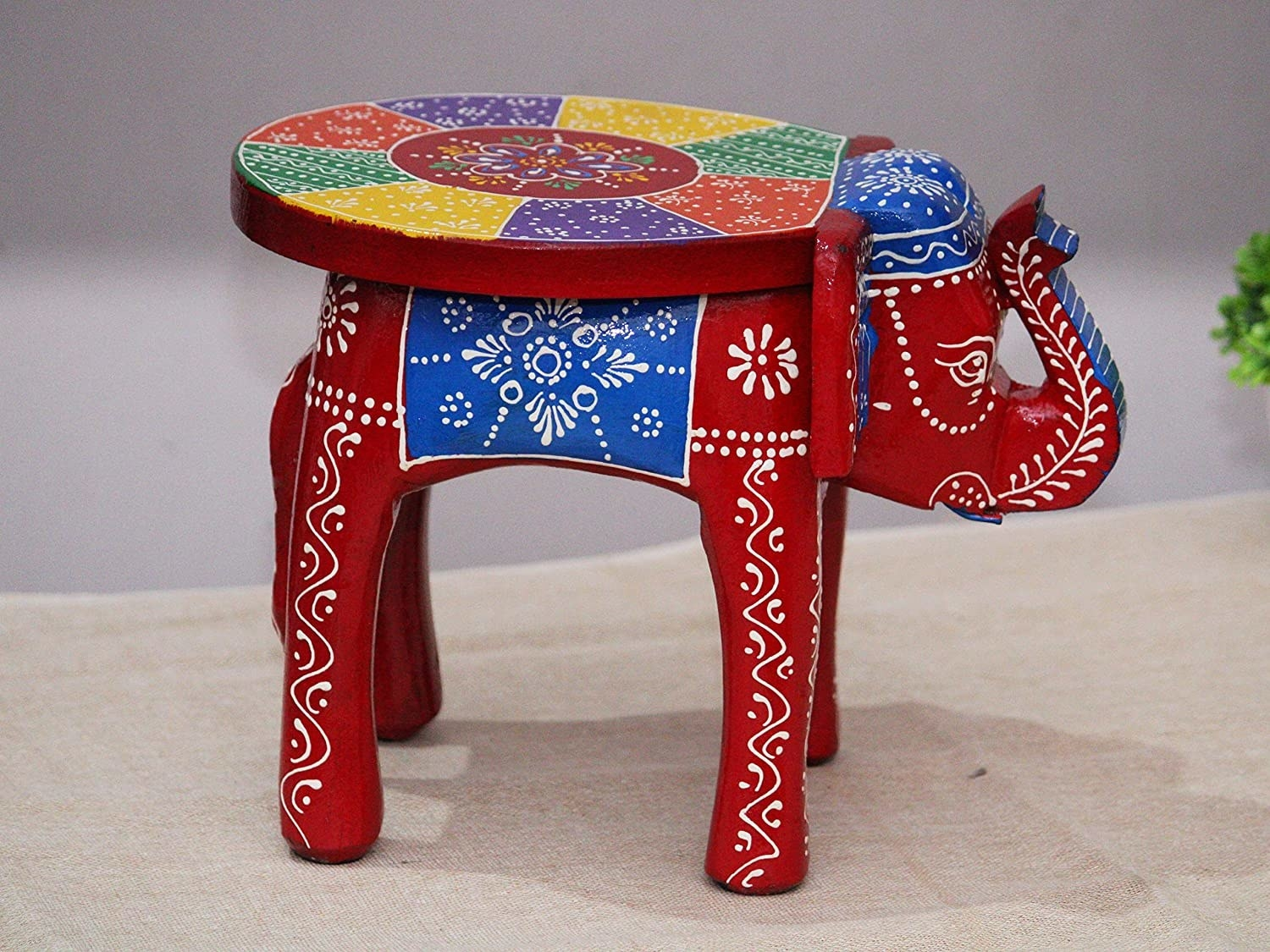 A colourful stool built in the shape of an elephant