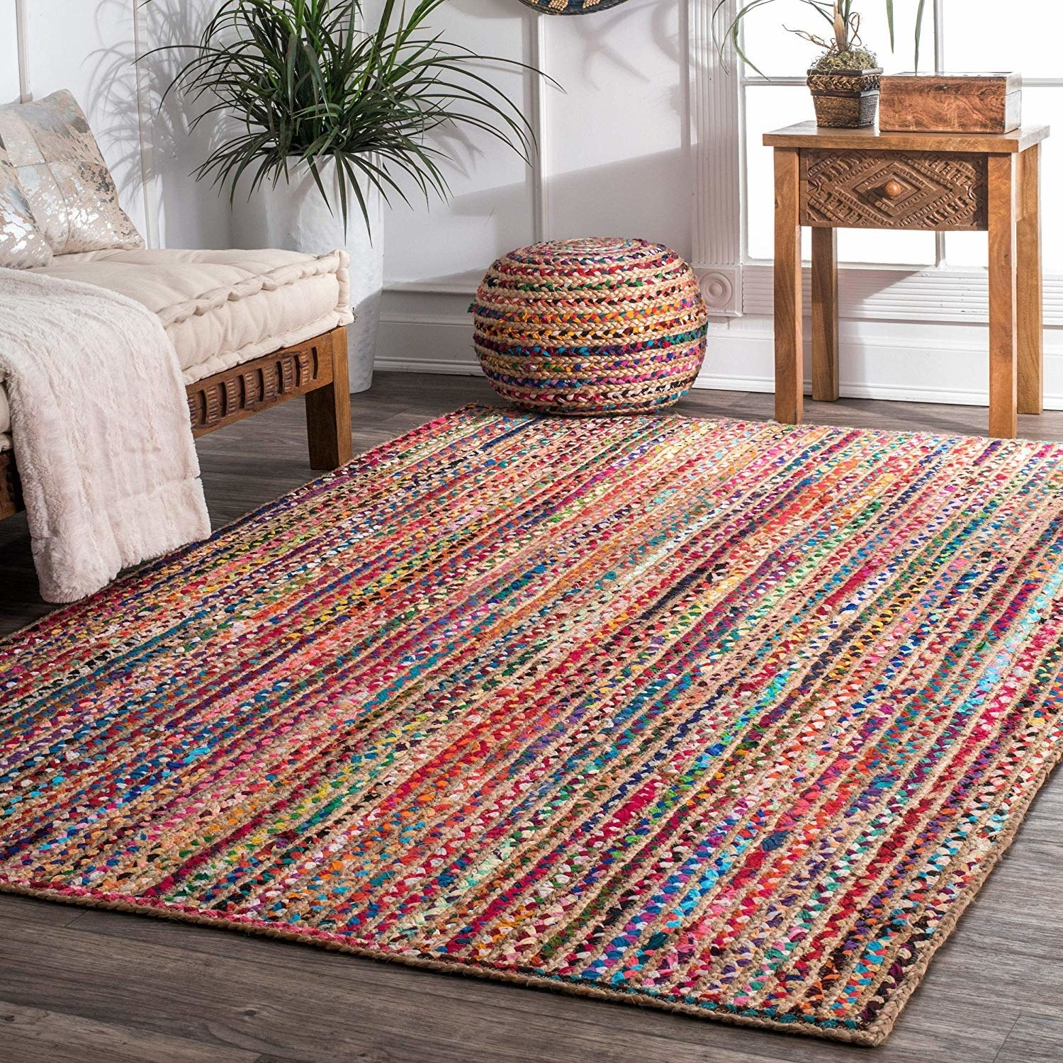 A multi-coloured braided cotton and jute rug