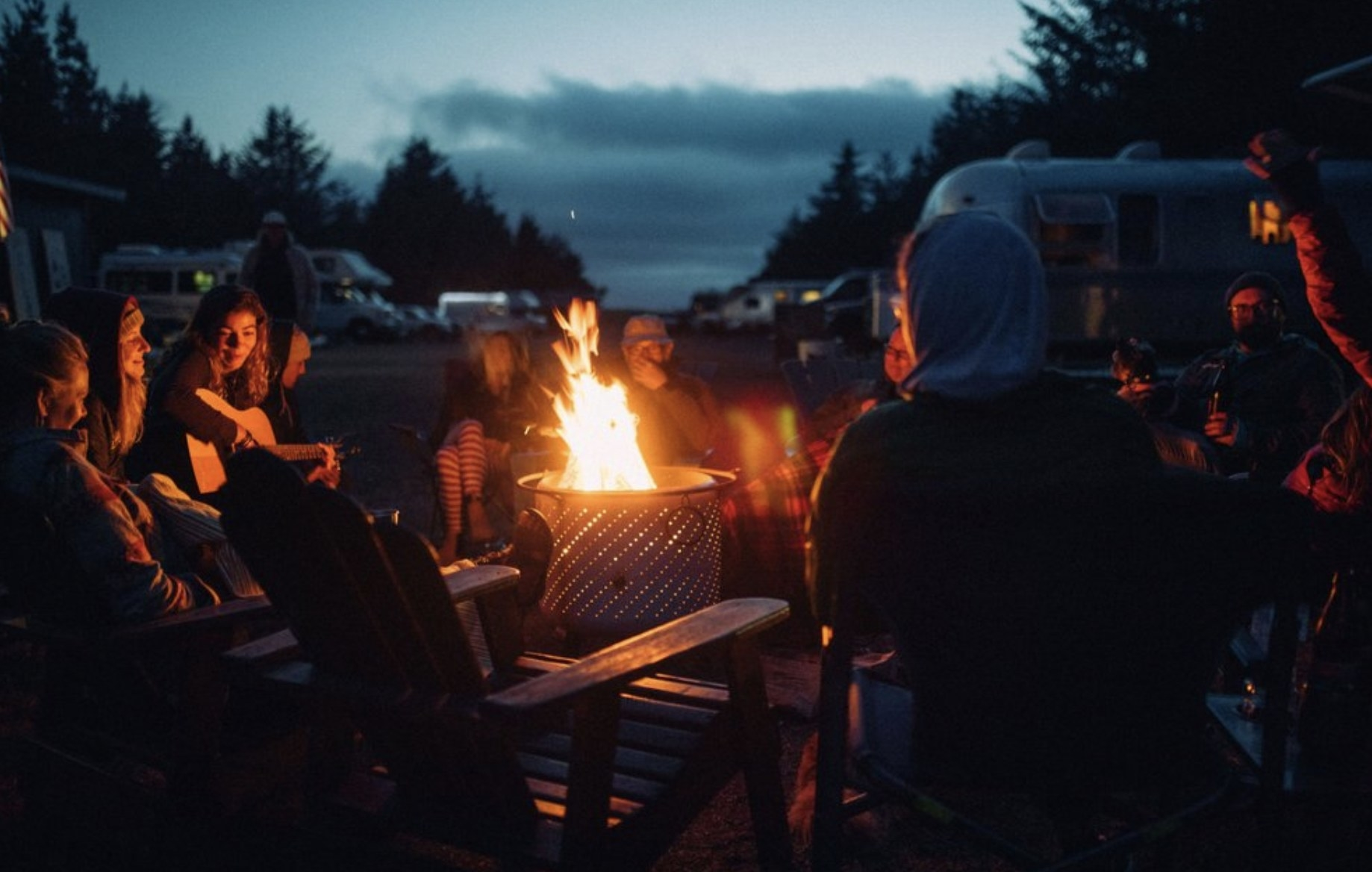 People gathering around a campfire