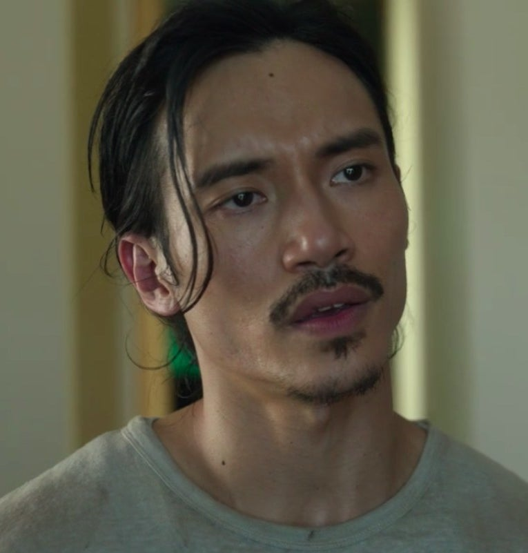 Close-up of Yao with messy hair, one strand hanging in his face
