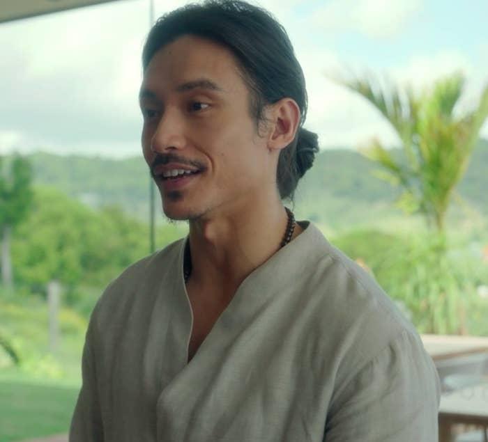 Manny Jacinto as Yao smiles
