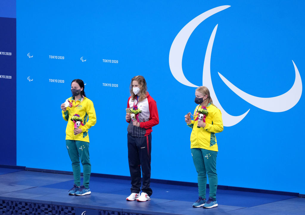 Russian Paralympic Committee's Valeriia Shabalina (centre) with the gold medal, Australia's Paige Leonhardt (left) with the silver medal and Australia's Ruby Storm with the bronze medal after the Women's 100m Butterfly - S14 Final